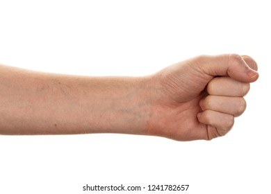 male hand outstretched to the side and showing a fist is isolated on white background