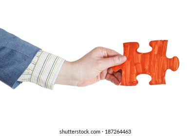 male hand with painted red puzzle piece isolated on white background