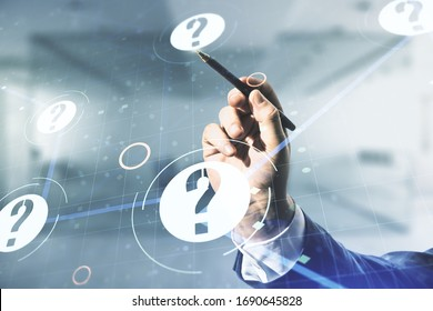 Male hand with pen draws abstract virtual question mark sketch on blurred office background, FAQ and research concept. Double exposure