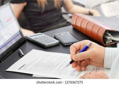 Male hand with pen signing a contract