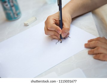 Male hand with pen and white sheet of paper
