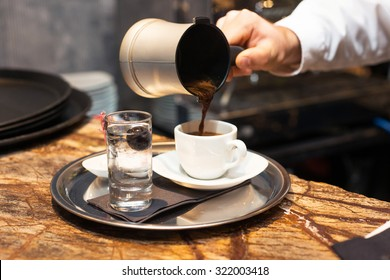 Male hand pouring Turkish Coffee