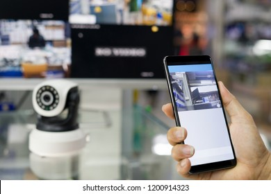 Male hand press phone watch CCTV