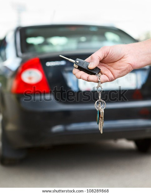 Male hand pressing on the remote control car alarm systems