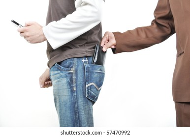 The male hand pulls out a purse from a pocket of the man.