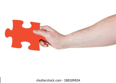 male hand with red puzzle piece isolated on white background