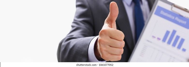 Male hand showing ok or confirm sign with thumb up during conference closeup. High level and quality product serious offer mediation solution happy client creative adviser participation concept