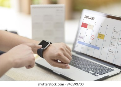 Male hand with smart watch on wrist. Planning agenda and schedule using calendar event planner. Calender planner, relax time remind concept.