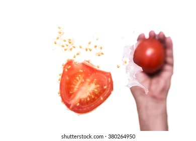 male hand is throwing a tomato against a pane, below shot