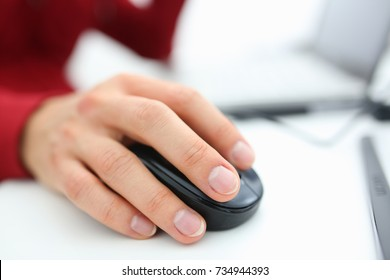 Male hand used computer mose holding in arm. Search for information for earnings in the Internet