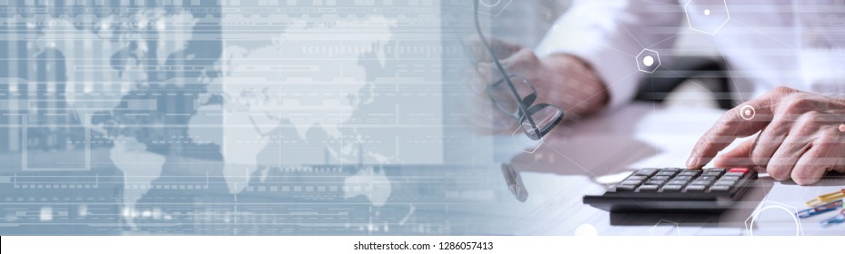 Male hand using calculator, accounting concept, light effect, overlayed with diagrams. panoramic banner