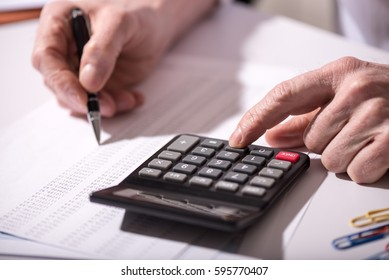 Male hand using calculator, accounting concept