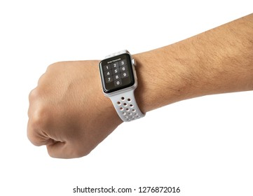 Male hand using with white smart watch. Enter a password.