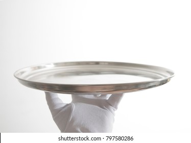 male hand with white gloves carrying a tray isolated on white background. empty tray