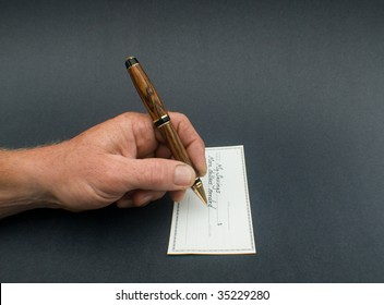 male hand writing check to savings for more dollars needed