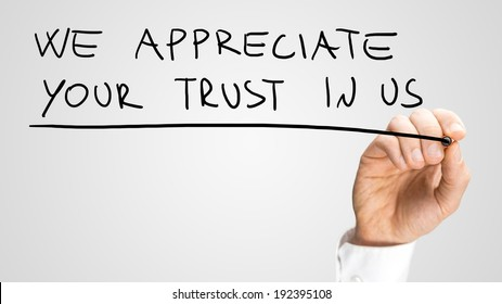 Male hand writing We appreciate your trust in us on virtual screen.