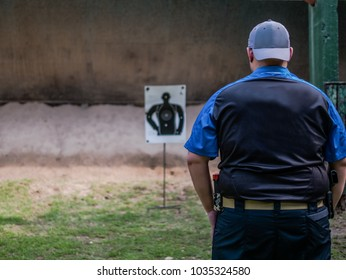 male with handgun in holster standby for shooting competion