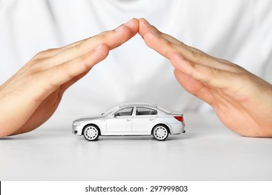 Male hands and car as protection of car concept