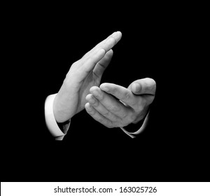 Male hands clapping isolated over black background
