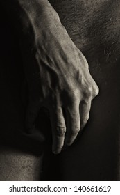Male hands covering crotch closeup