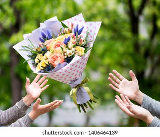 Male hands defied bouquet flowers girl. Romantic gift