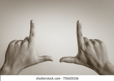 Male hands framing composition. Isolated on white background.