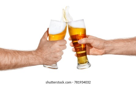 male hands with glass of beer toasting creating splash isolated on white background