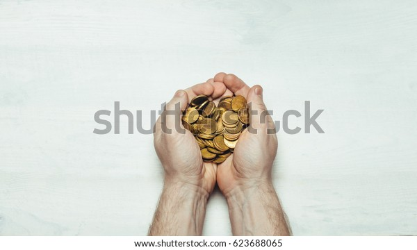 Male hands with handful of coins in the palms on light white background. Flat style