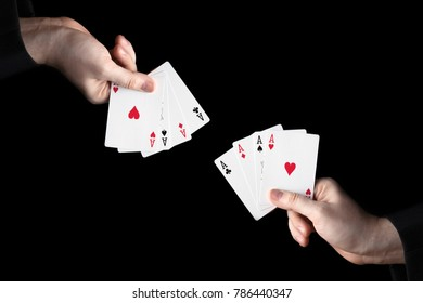 male hands hold a fan of playing cards on a black background