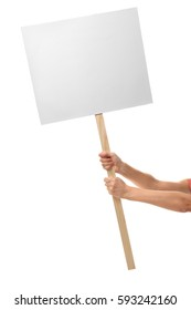 Male hands holding blank banner on wooden stick against white background