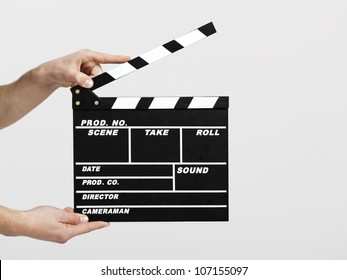 Male hands holding a clapboard, great conceptual image for ex, a new start your business