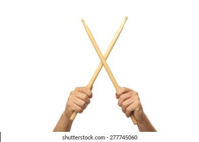 Male hands holding drum sticks
