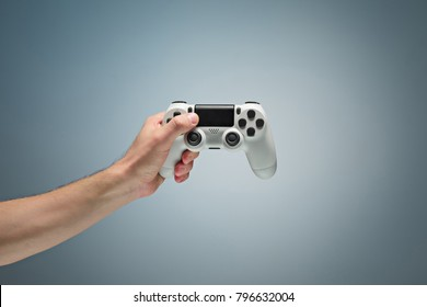 Male Hands Holding Gamepad