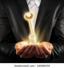 Male hands holding a golden key