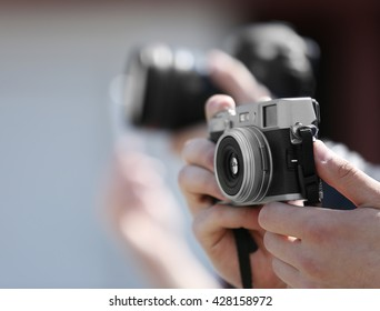 Male hands holding old camera, closeup