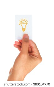 male hands holding paper writing lamp on white background, idea concept.