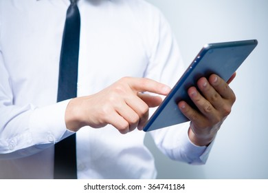 Male hands holding a tablet close up
