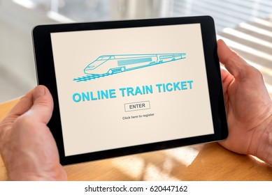 Male hands holding a tablet with online train ticket concept