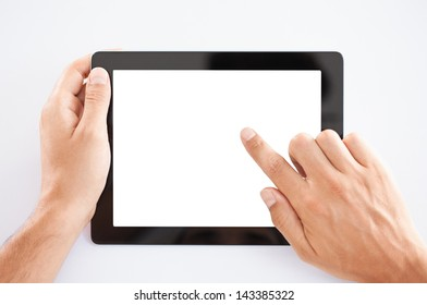 Male hands holding a tablet PC.