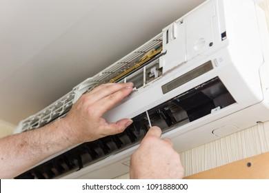 Male hands with instruments make ac condition maintenance