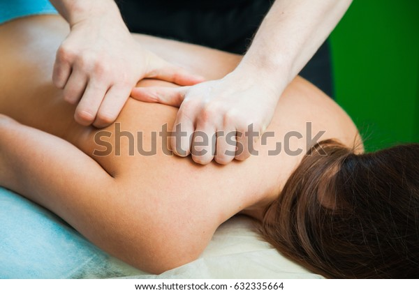 Male hands massaging female body. Spa health care relax concept