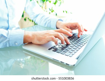 Male hands or men office worker typing on the keyboard