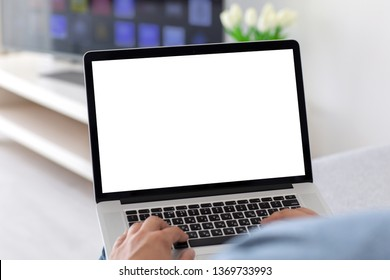 male hands on keyboard laptop with isolated screen in the house in room