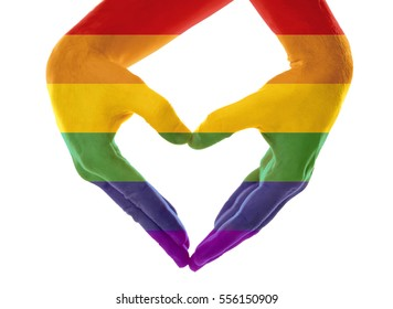 Male hands painted in LGBT flag making heart on white background