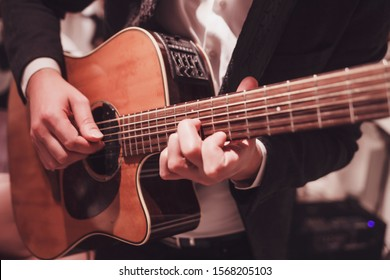 male hands playing the guitar. practice to play the instrument