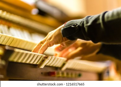 male hands playing organ keyboard in church