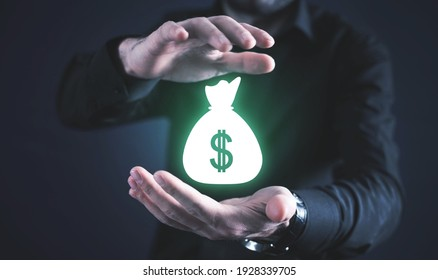 Male hands protect money bag. Business. Finance. Wealth