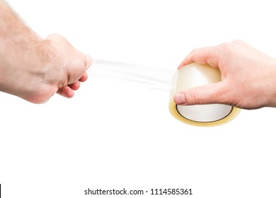 Male hands use an adhesive tape, isolated on a white background, first-person view