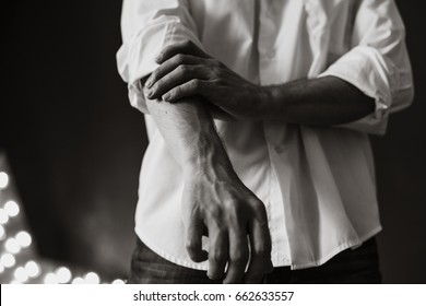 male hands in a white shirt
