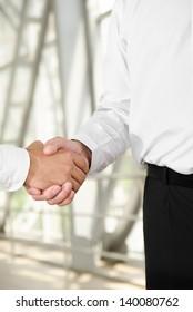 Male handshake isolated on business background